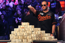 Greg Merson holds up his new bracelet after winning the World Series of Poker No-Limit Hold'em Main Event. Photo / AP