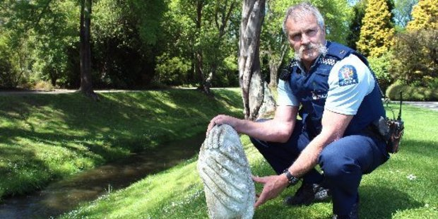 Oamaru police Community Constable Bruce Dow is seeking information from the public to identify this piece of Oamaru stone from a statue. Photo / Rebecca Ryan