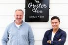 Jonathan Rutherfurd-Best and Andrew Glenn outside The Oyster Inn on Waiheke Island. Photo / Babiche Martens