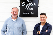 Jonathan Rutherfurd-Best and Andrew Glenn outside The Oyster Inn on Waiheke Island. Photo / Babiche Martens