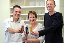 Researchers (from left) Jim Cotter, Fiona Nyhof and Patrick Silcock with their jetlag drinks. Picture / Otago Daily Times