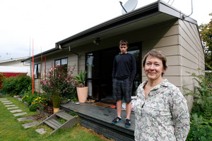 Antoinette van der Weerden, with her son Soloman Caldswell, says she noticed the difference the insulation made straight away. Photo / Christine Cornege