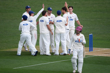 Auckland's Dean Bartlett celebrates the wicket of James Marshall. ND were torn apart twice by the Aces' bowlers. Photo / Photosport