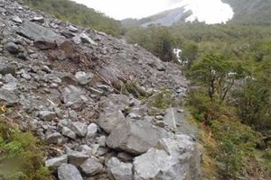 Boulders weighing up to 200 tonnes crashed onto the Milford Road in October. Photo / File / Supplied