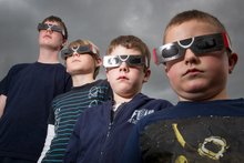 From left, Connor Hackney, 13, Jackson Clayton, 11, Liam Hackney, 8, and Caleb McCormack-King, 7, show off their protective eclipse glasses. Photo / Kellie Blizard