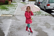 Bonnie Reid stands in a pile of hail after a freak hailstorm. Photo / Supplied