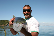 Rugby player Sammy Tuitupou caught his first kingfish slow trolling at The Noises. Photo / Geoff Thomas 