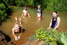 Manawaru School pupils Riannon Vickers (12), Sergio Schuler (12), Jeremy Blair (12) and Belinda Hendriks (13) can now enjoy swimming in the Te Horo stream following the Enviroschools clean-up project. Photo / Christine Cornege