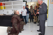 The Prince of Wales meets The Hobbit dwarf Dori, played by Mark Hadlow, during his visit to Weta Workshop in Miramar. Photo /