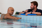 Oscar Kightley (left) sets an example with a swimming lesson from instructor Andrew Brown. Photo / Steven McNicholl