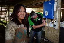 Competition winner Mai Digby watches as a Splash monitoring system is installed in her home.  Photo / Doug Sherring