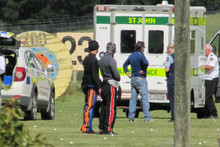 Emergency services attend the scene of a skydiver's fatal crash near Wanaka Airport yesterday. Photo / Otago Daily Times