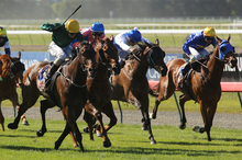 Nashville sweeps down the outside to win the Coupland's Mile at Riccarton yesterday. Photo / Getty Images