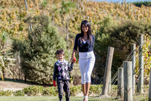 Celebrity chef Farah Quinn is here to showcase NZ to her 1.1 million Facebook friends and 343,000 Twitter followers. She's seen here with her son, Arman. Photo / Supplied