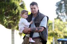 Builder Troy Jury works long hours to better support daughter Indi. Photo / Doug Sherring