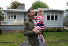 Phil Holden and daughter Lila outside their home in Mark Rd, Mt Albert that sold at auction recently. Photo / Doug Sherring