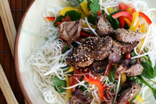 Pork is given an Asian flavour in this honey and sesame salad. Photo / Doug Sherring