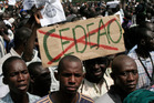 Malians opposing a foreign military intervention to retake Mali's Islamist-held north carry signs protesting. Photo / AP
