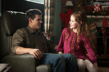 Werewolf Jacob Black (Taylor Lautner) keeps a close eye on Renesmee (Mackenzie Foy) in the final o the Twilight series. Photo / AP