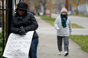 Shena Hardin holds up a sign to serve a highly public sentence. Photo / AP