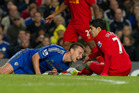 John Terry (left) scored for Chelsea but was later taken off after a collision with Liverpool's Luis Suarez. Photo / AP