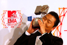 South Korean Psy kisses his award for best video during the 2012 MTV European Music Awards show. Photo/AP