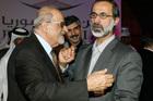 Coalition of anti-Assad leaders unite behind moderate Muslim cleric after marathon talks Haytham al-Maleh (left) congratulates Maath al-Khatib on his election. Photo / AP