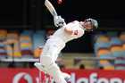 Australia's Michael Clarke reacts to a bouncer on the fourth day of the first cricket test match between Australia and South Africa, at the Gabba stadium in Brisbane, Australia, Monday, Nov. 12, 2012.