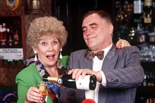 Vera Duckworth (Liz Dawn) and Jack Duckworth (Bill Tarmey) behind the bar in Rovers. Photo / Supplied