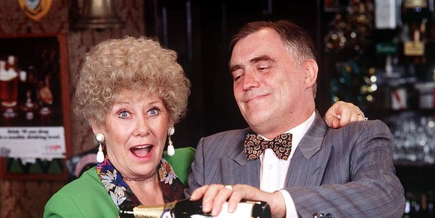 Vera Duckworth (Liz Dawn) and Jack Duckworth (Bill Tarmey) behind the bar in Rovers. Photo / Supplied