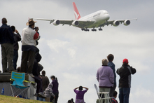 Qantas' Airbus A380 aircraft, watched by spectators at the Puhinui lookout, comes in to land at Auckland Airport, October 10, 2008. Photo / Paul Estcourt