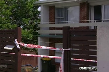 A house in Manurewa is searched by police after the fatal stabbing of Inayat Kawthar.  Photo / One News
