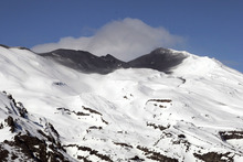 The blackened crater of Mt Ruapehu after it erupted in 2007. Photo / John Cowpland