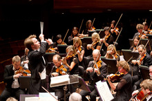 NZSO musical director Pietari Inkinen with the NZSO. Photo / Patrycja Szarczynska