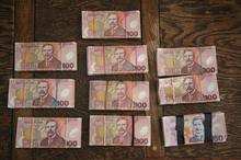 This is what $100,000 looks like and was found in an ammunition tin in a Far North paddock. Photo / The Northern Advocate
