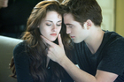 Kristen Stewart, left, and Robert Pattinson are more tolerable in the final Twilight film. Photo/AP