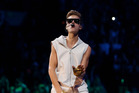 Justin Bieber has had a run in with police after making a dangerous turn in his supercar. Photo/AP