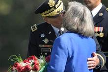 Former Commander of International Security Assistance Force and U.S. Forces-Afghanistan Gen. Davis Petraeus kisses his wife Holly at a government event. Photo / AP