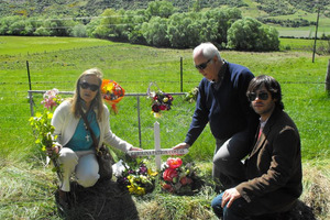 The family of accident victim Carolina Patron Costas, her mother Magdalena, father Jose and brother Jose jun, lay flowers at the scene of last week's fatal crash. Photo / Olivia Caldwell