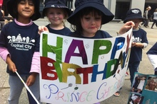 Capital City preschool four-year-olds Ishani, Lilly and Morgane welcome Prince Charles to Wellington. 