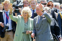 Prince Charles, Prince of Wales and Camilla, Duchess of Cornwall wave to the crowd at Manchester Square in Feilding. Photo / Getty Images