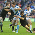 Nick de Luca of Scotland is tackled by Tamati Ellison and Richie McCaw. Photo / Getty Images