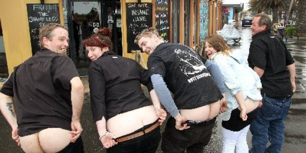 Pier Side Cafe employees and New Brighton residents are busy practising for the Bare Your Bum for Brighton protest. Photo / Geoff Sloan