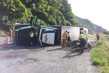 Emergency services staff attend a truck crash on State Highway 1. Photo / Daniel Pannett