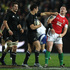 New Zealand's Daniel Carter has an altercation with Matthew Rees of Wales, 2010. Photo / NZPA