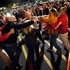 A crowd gathers as security guards break up a fight between shoppers waiting in line just as the doors open for Black Friday shopping at Target.  Photo / AP