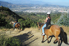A guided horse ride at Sunset Ranch takes you through one of the largest urban parks in the US. Photo / Rob McFarland