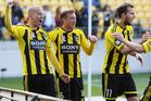 Phoenix players Stein Huysegems (l), Alex Smith (c) and Jeremy Brockie celebrate.