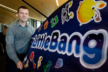 BigLittleBang founder Chris White sets up for his pitch at the Angel Summit event in Wellington. Photo / Mark Mitchell
