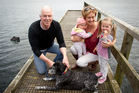Pete Taylor and his wife Faith with their two grandchildren Tilly Hughes, eight months, and Kaitlin Hughes, 3. Photo / Dean Purcell